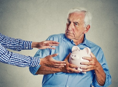 someone trying to steal a senior citizen's piggy bank