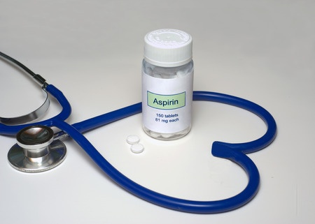 Low dose aspirin in a heart shaped stethoscope