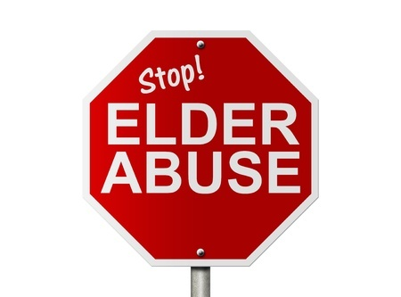 stop sign with the words stop elder abuse