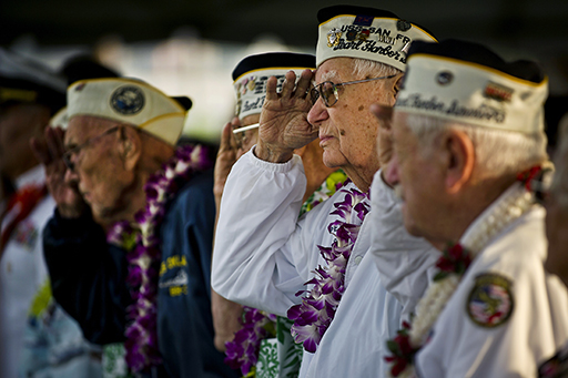 Pearl Harbor Survivor and World War II veteran Edgar Harrison salutes as the national anthem is played during a Dec. 7, 2012, remembrance ceremony marking the 71st anniversary of the attack on Pearl Harbor and the island of Oahu, at the World War II Valor in the Pacific National Monument, formerly known as the USS Arizona Memorial Visitor Center in Honolulu. On the morning of Dec. 7, 1941, a surprise attack by the Imperial Japanese Navy against U.S. Pacific Forces on the Hawaiian Islands thrust the United States in World War II. The attack lasted 110 minutes, from 7:55 a.m. until 9:45 a.m. A total of 2,335 U.S. servicemen were killed and 1,143 were wounded. (Department of Defense photo by U.S. Air Force Tech. Sgt. Michael R. Holzworth/Released)