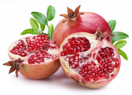8000347 - juicy opened pomegranate with leaves. isolated on a white background.