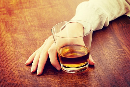 36534199 - yound beautiful woman in depression, drinking alcohol