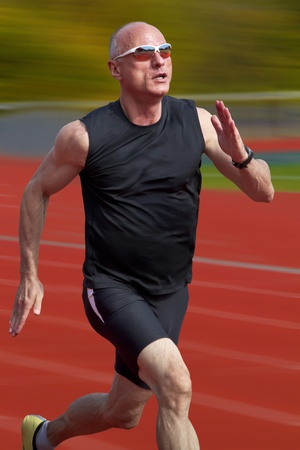 10904990 - male sprinter in middle age trains for race competition